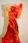 Fire, embroidered figure