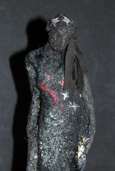 embroidered figure
